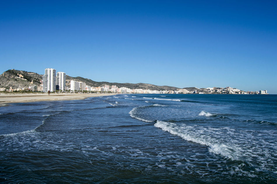 Cullera Beach Architecture Beauty In Nature Blue Built Structure City City Life Cityscape Clear Sky Coastline Cullera Day Nature No People Outdoors Rippled S Scenics Sea Sky Tourism Tranquil Scene Tranquility Travel Destinations Valencia,S Water
