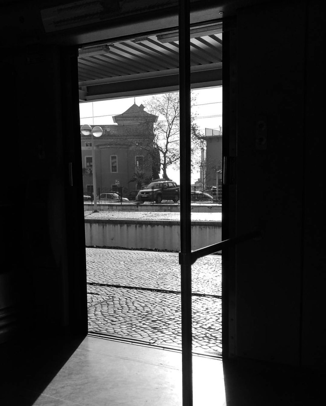 Sliding Door City Looking Through Window Architecture