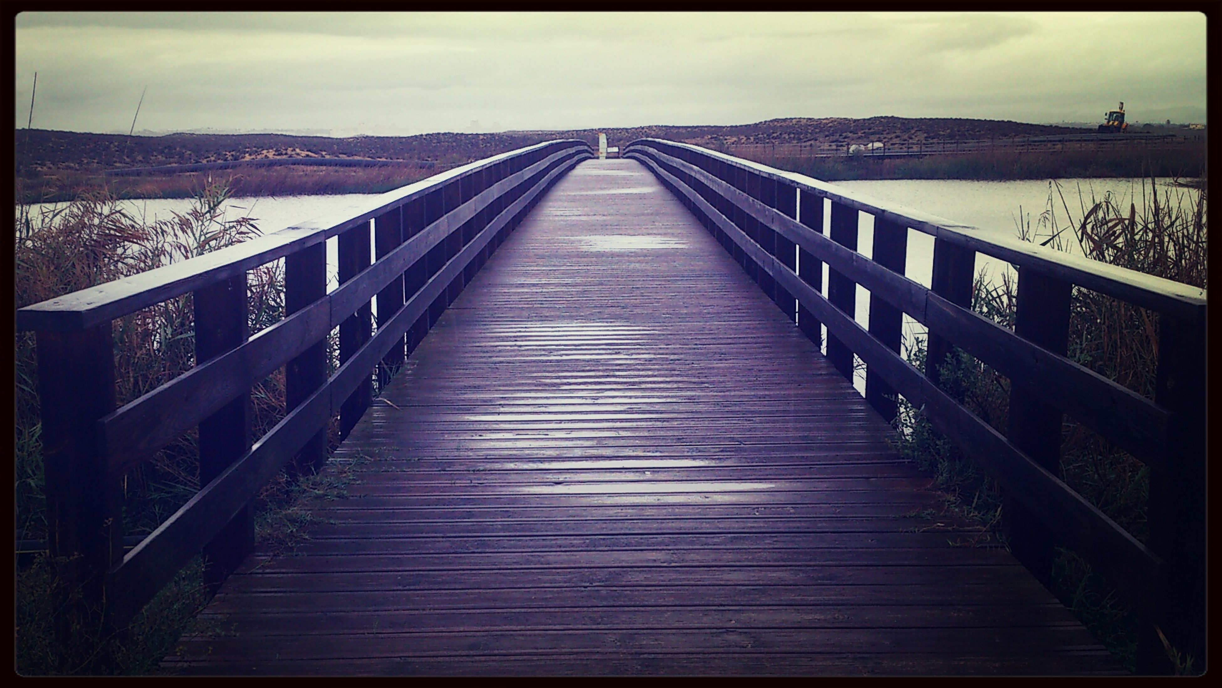 transfer print, the way forward, wood - material, boardwalk, railing, water, auto post production filter, pier, sky, tranquility, footbridge, tranquil scene, diminishing perspective, wood, wood paneling, built structure, long, scenics, nature, connection