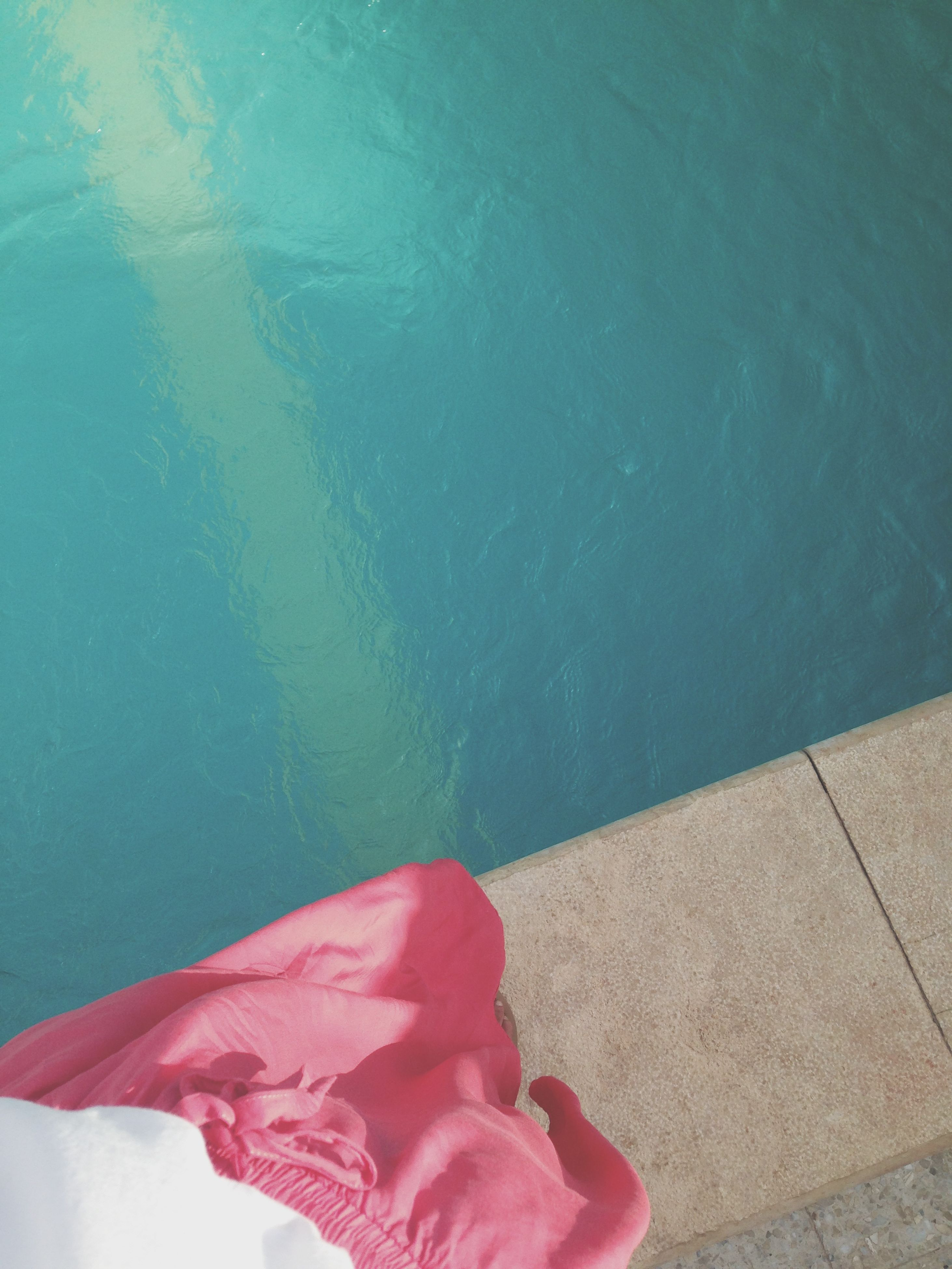 water, high angle view, low section, swimming pool, person, blue, lifestyles, red, standing, day, wet, leisure activity, outdoors, sunlight, pink color, human foot, barefoot, personal perspective