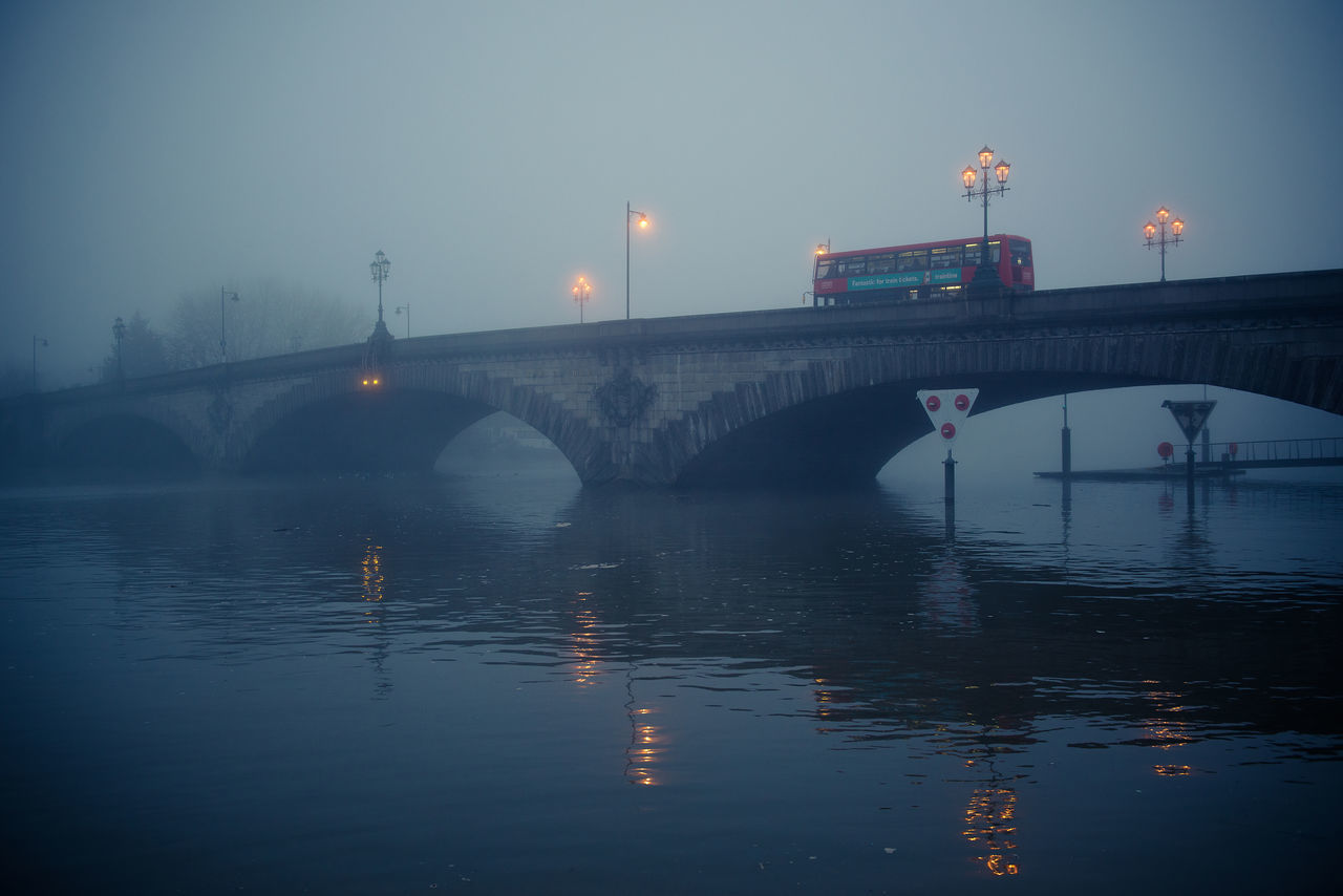Bridge Bridge - Man Made Structure Fog Foggy Day Foggy Evening Gloomy Gloomy Weather Illuminated Kew Bridge London Outdoors Reflection River Street Light Thames Thames River Water Double Decker Bus Double Decker Red Bus London Bus