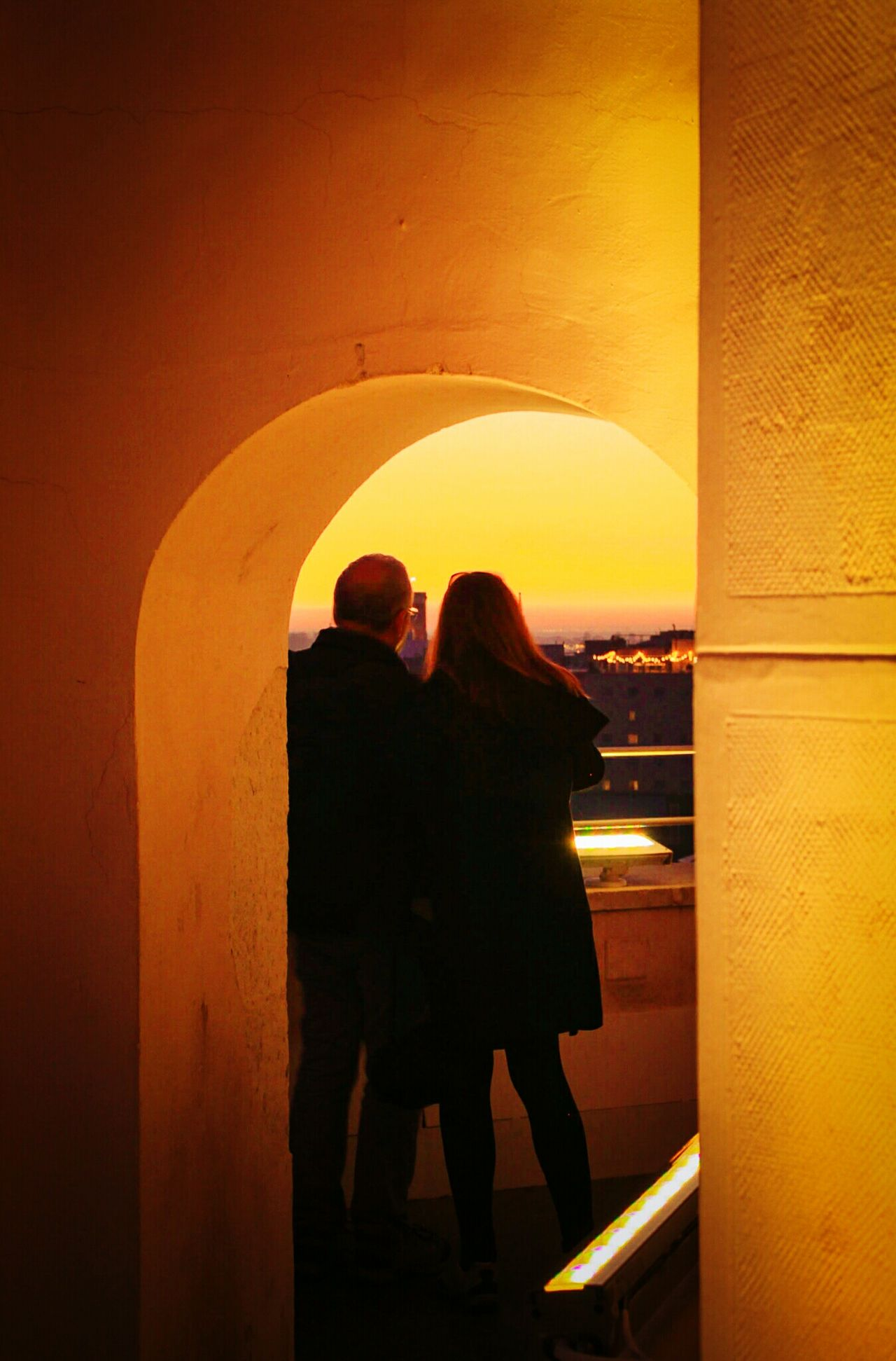 Rear View Romance Couple - Relationship Two People Arch Togetherness Love Standing Adults Only Night People Sunset Watching The Sunset Orange Color Yellow And Orange Palacio De Correos Madrid Mirador EyeEm Gallery Check This Out The City Light