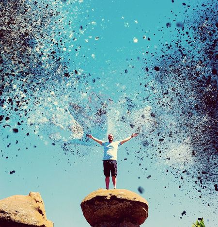 Dispersion Effect Arms Outstretched Arms Raised Human Arm Full Length Blue Day One Person Real People Standing Water Leisure Activity Outdoors Adult Adults Only Human Body Part Sky Men Happiness Nature People Photoshop Adobe Photoshop