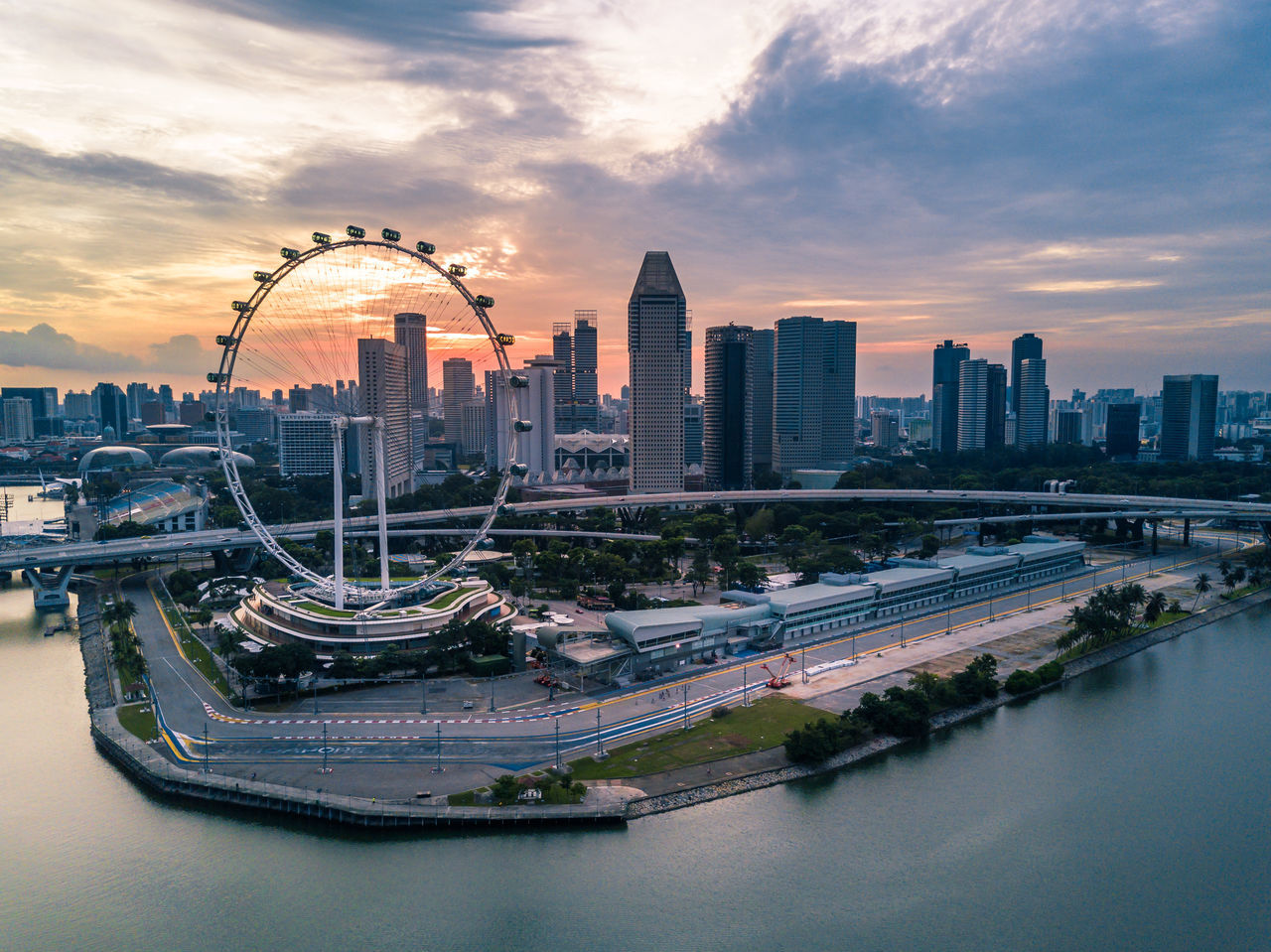 Architecture Building Exterior Built Structure City Cityscape Cloud - Sky Day Drone  Dronephotography Marina Bay Modern Nature No People Outdoors Sky Skyscraper Sunset Travel Destinations Urban Skyline Water Waterfront