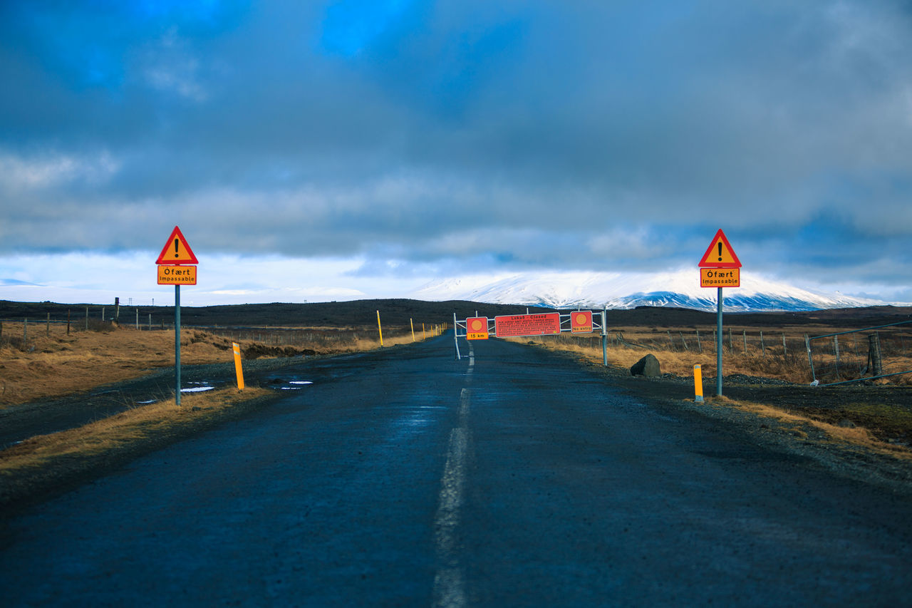 Beauty In Nature Close-up Cloud - Sky Communication Day Direction Guidance Iceland Infinity Landscape Nature No People Out Of Control Outdoors Road Road Sign Scenics Sky Speed Limit Sign The Way Forward