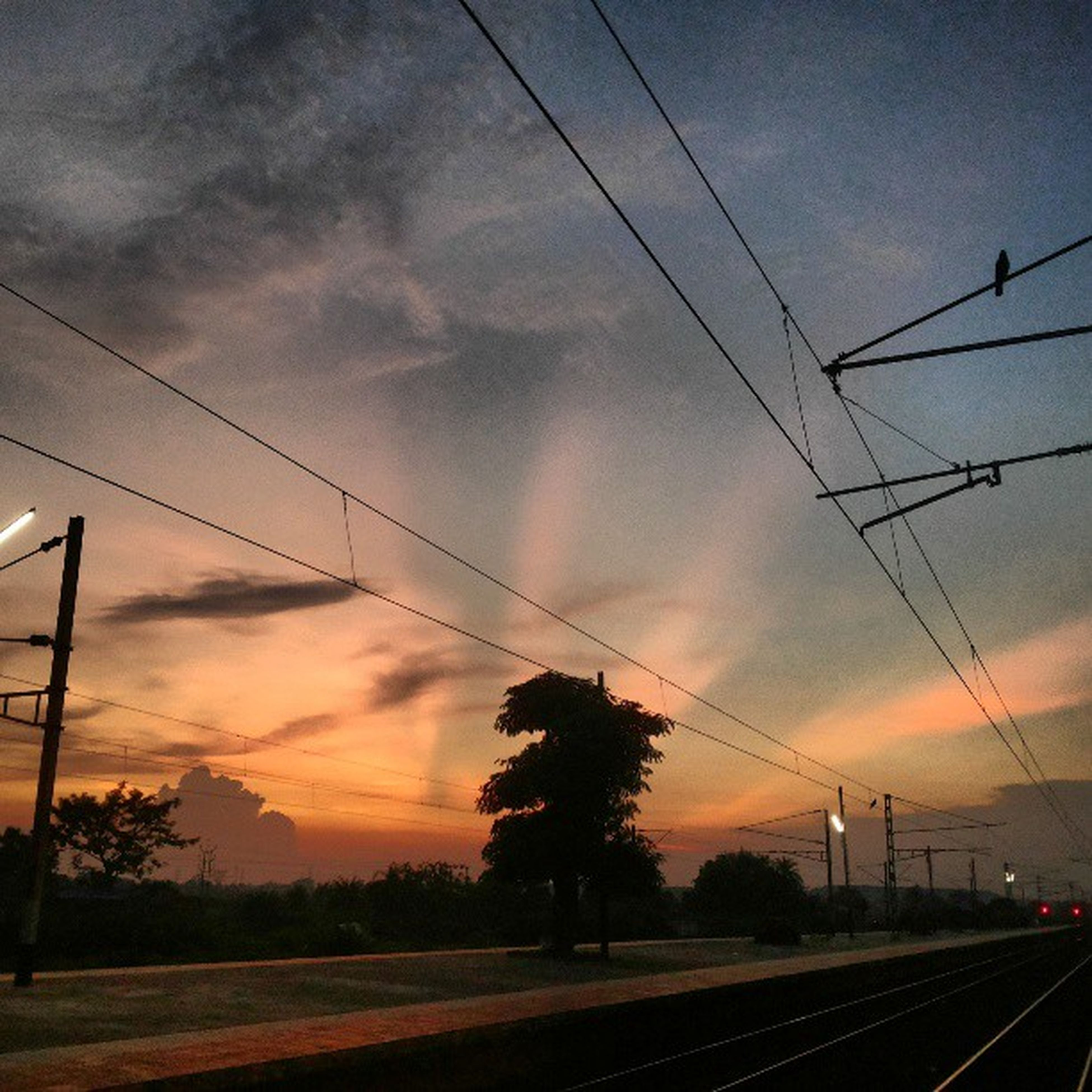 power line, electricity pylon, sunset, sky, power supply, cable, electricity, connection, cloud - sky, power cable, fuel and power generation, transportation, silhouette, railroad track, orange color, cloud, cloudy, landscape, scenics, technology