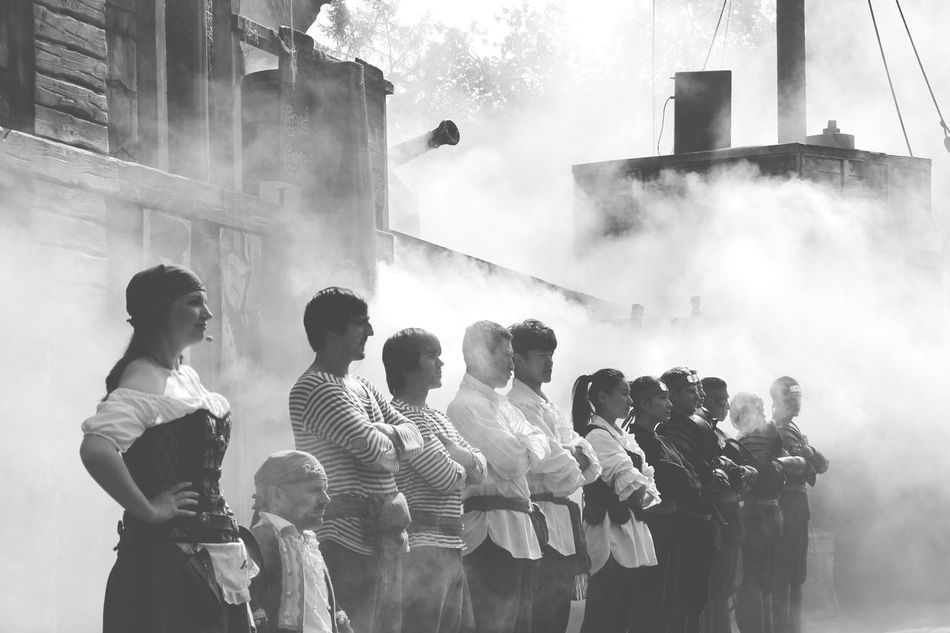 Beautiful stock photos of piraten, smoke - physical structure, men, large group of people, medium group of people