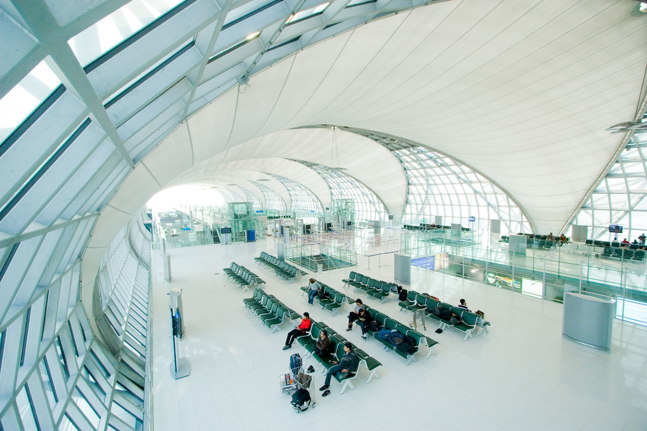 Suvarnabhumi International Airport Terminal. Airport Architecture Building Feature Building Interior Built Structure Business City City Life Day Departure Flight Futuristic Gate Hall Indoors  International Large Group Of People Modern People Seats Suvarnabhumi Terminal Travel Waiting White
