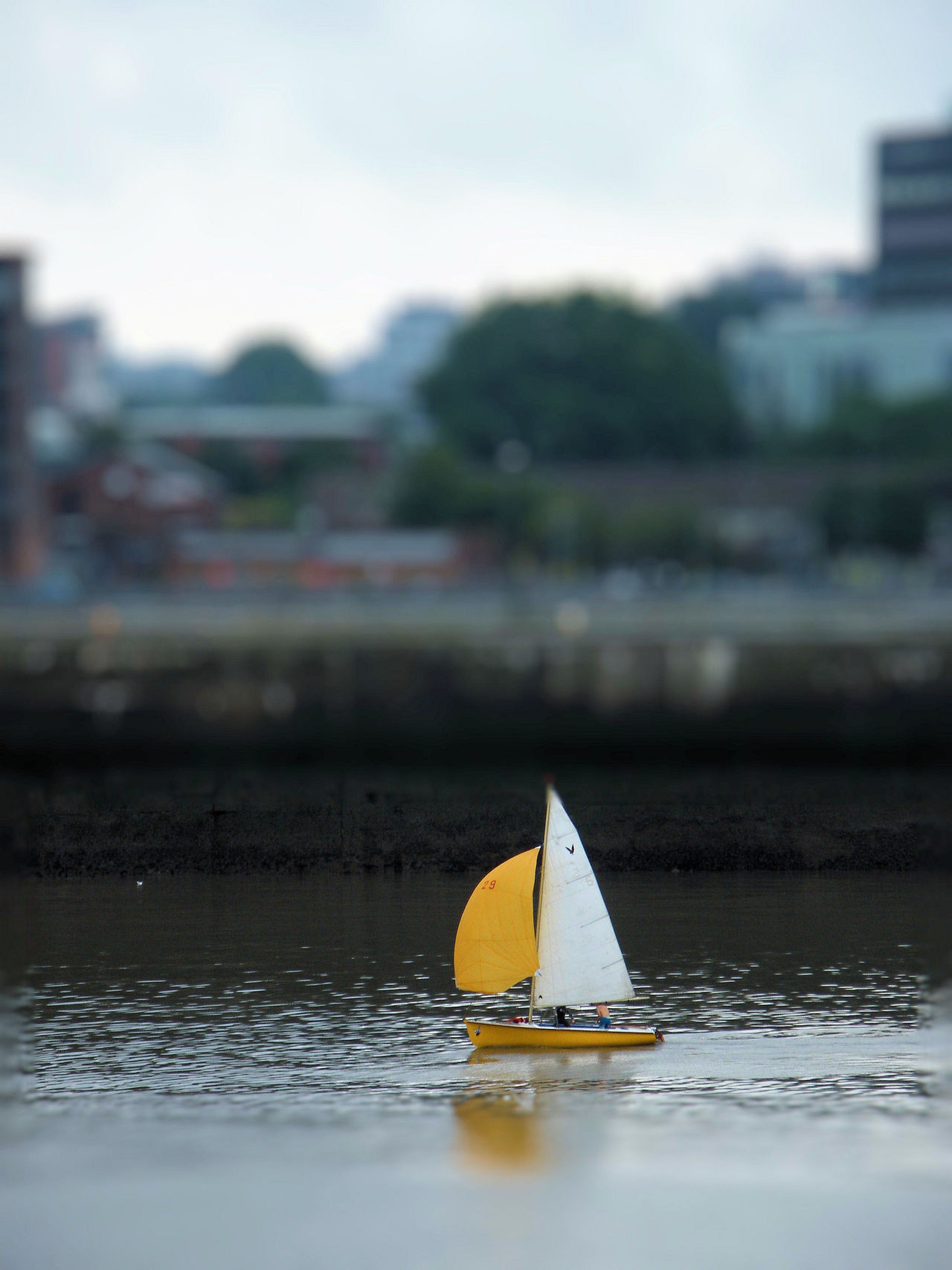 29 Boat Dingy Harbour Front Liverpool Nautical Vessel Sailboat Sailing Sailing Boat Sailing By Sailing Dingy Sky The Wind In The Sails Tilt Shift Two Men In A Boat Water Yellow Sail