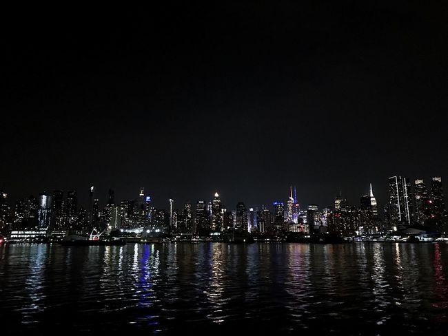 Night Skyscraper Illuminated Architecture Cityscape Building Exterior Modern Built Structure City Waterfront Travel Destinations Urban Skyline No People Water Sky Outdoors Horizon Over Water Ferry Views New York City NYC Cityscape Clear Sky City Tranquility