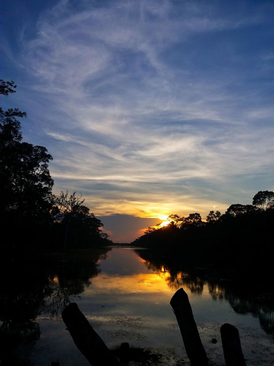 Silhouette infront of Angkor Ancient gate in Cambodia. Water Sunset Nature Horizon Over Water Scenics Outdoors No People Lake Cloud - Sky Silhouette Angkor Thom Cambodia Khmer Golden Hour