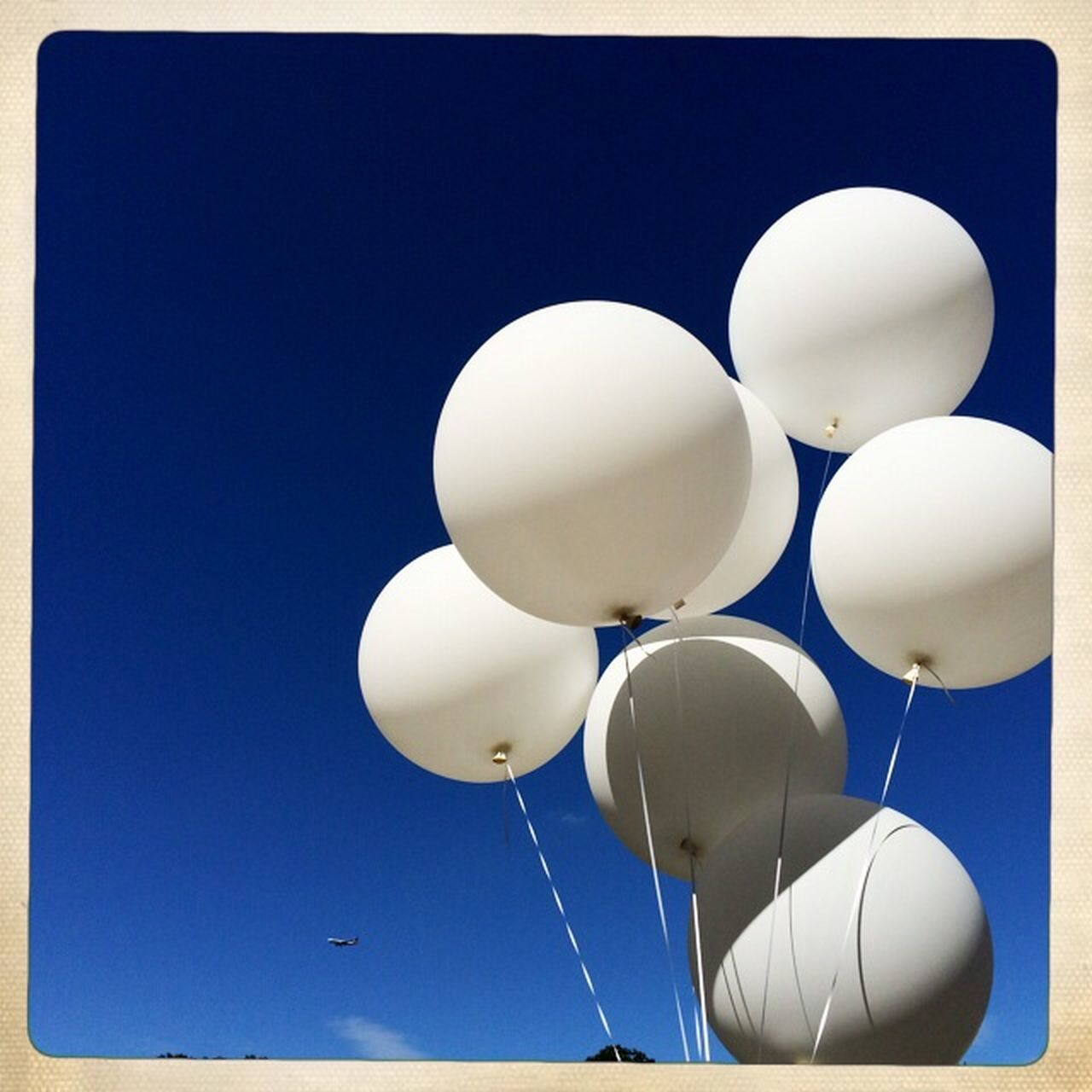 balloon, blue, helium balloon, low angle view, helium, celebration, day, no people, outdoors, clear sky, sky