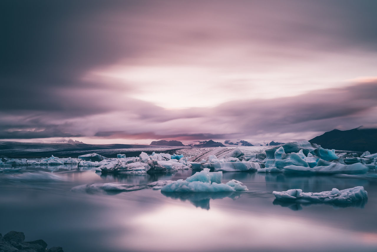 light opens up over the glacial ice lagoon Beauty Beauty In Nature Glacier Glaciers Iceberg Iceland Iceland_collection La Lake Landscape Landscape_photography Market Moody Moody Sky Mountain Natural Nature Outdoors Photography Premium Reflection Serenity Water