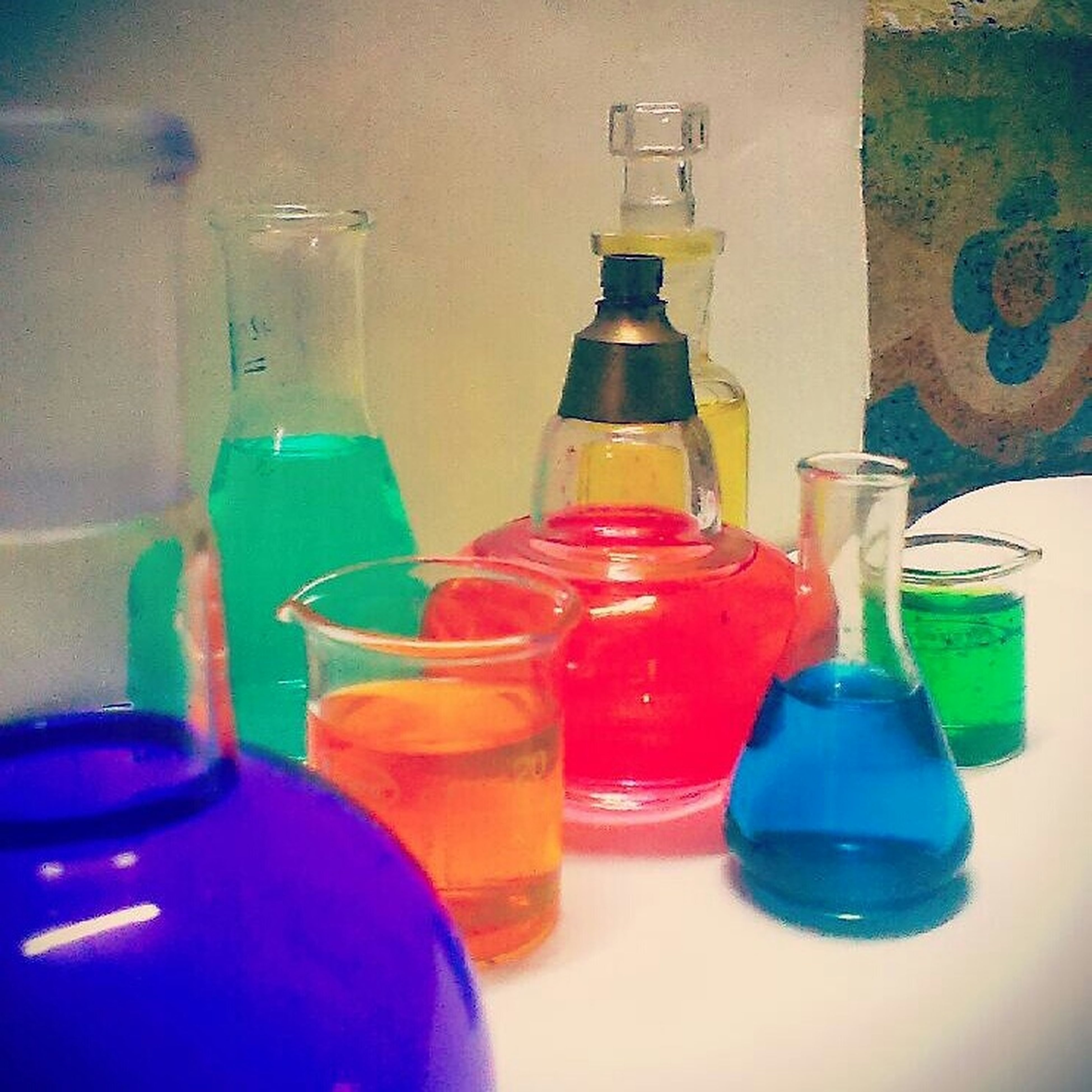indoors, still life, blue, bottle, multi colored, close-up, table, plastic, variation, glass - material, drink, no people, container, drinking glass, red, green color, refreshment, in a row, empty, transparent