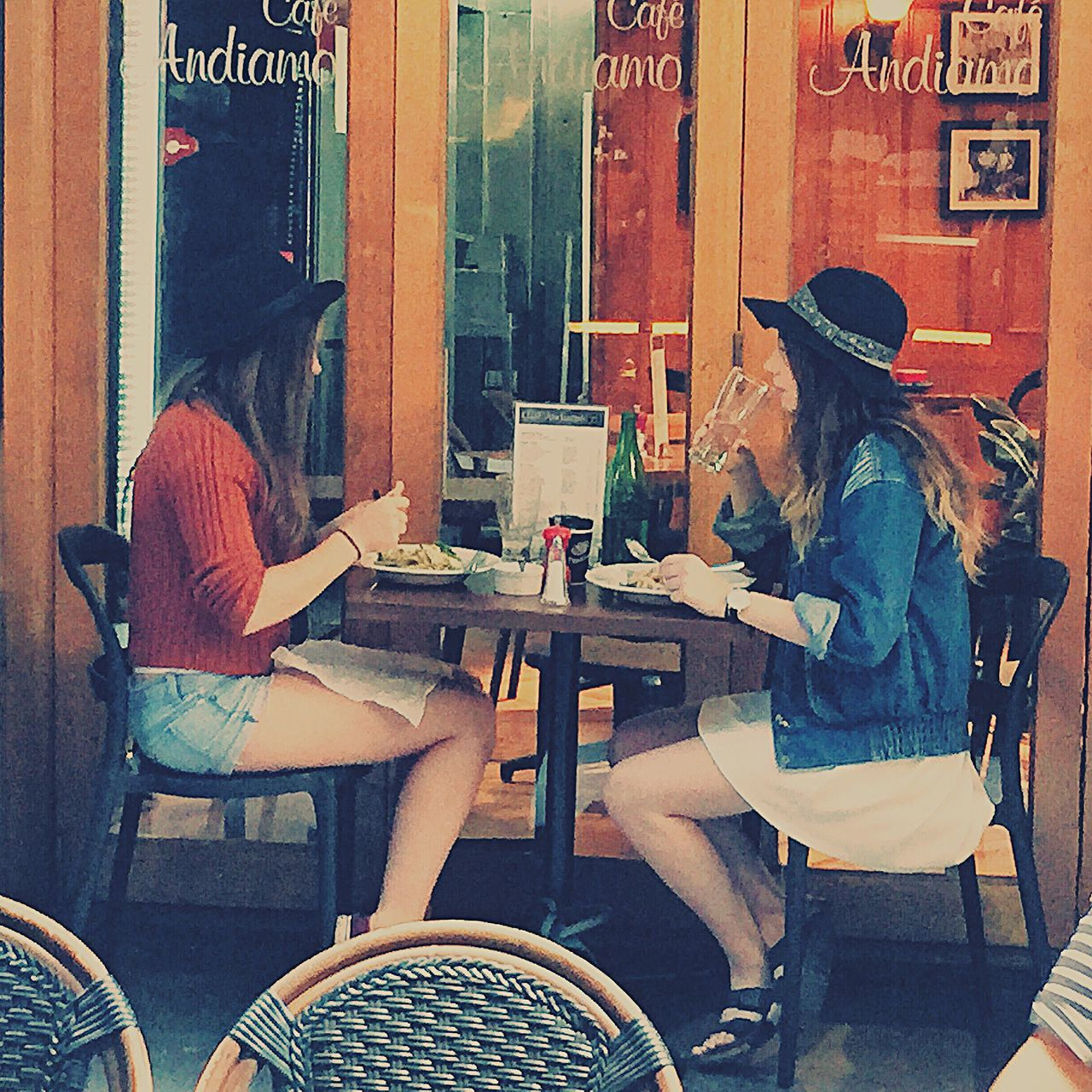 table, real people, women, cafe, restaurant, casual clothing, leisure activity, chair, food and drink, sitting, lifestyles, day, two people, men, outdoors, drink, young women, food, young adult, adult, people