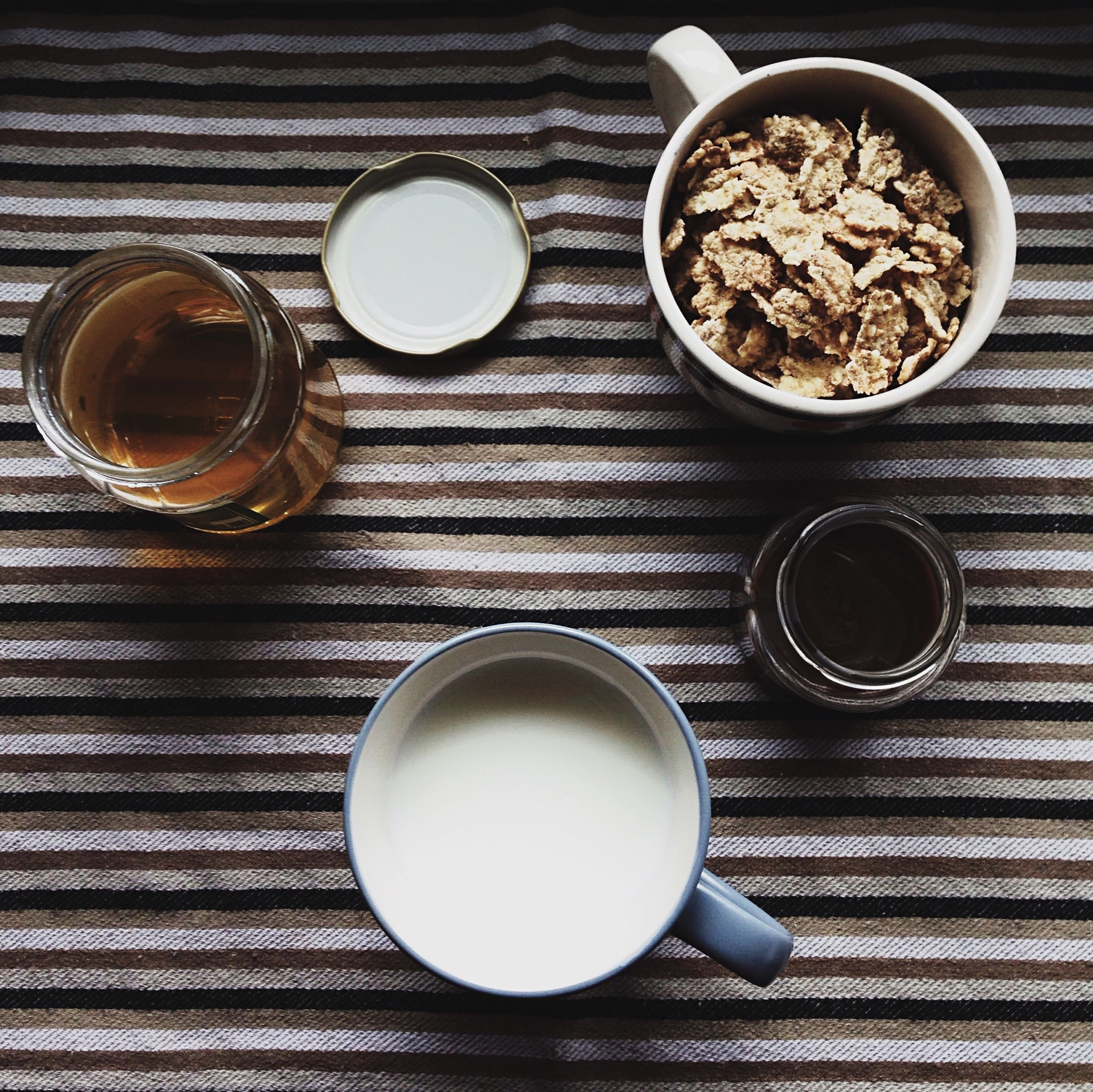 indoors, still life, high angle view, table, directly above, close-up, no people, coffee cup, circle, wood - material, bowl, food and drink, arrangement, drink, cup, container, metal, coffee - drink, large group of objects, spoon
