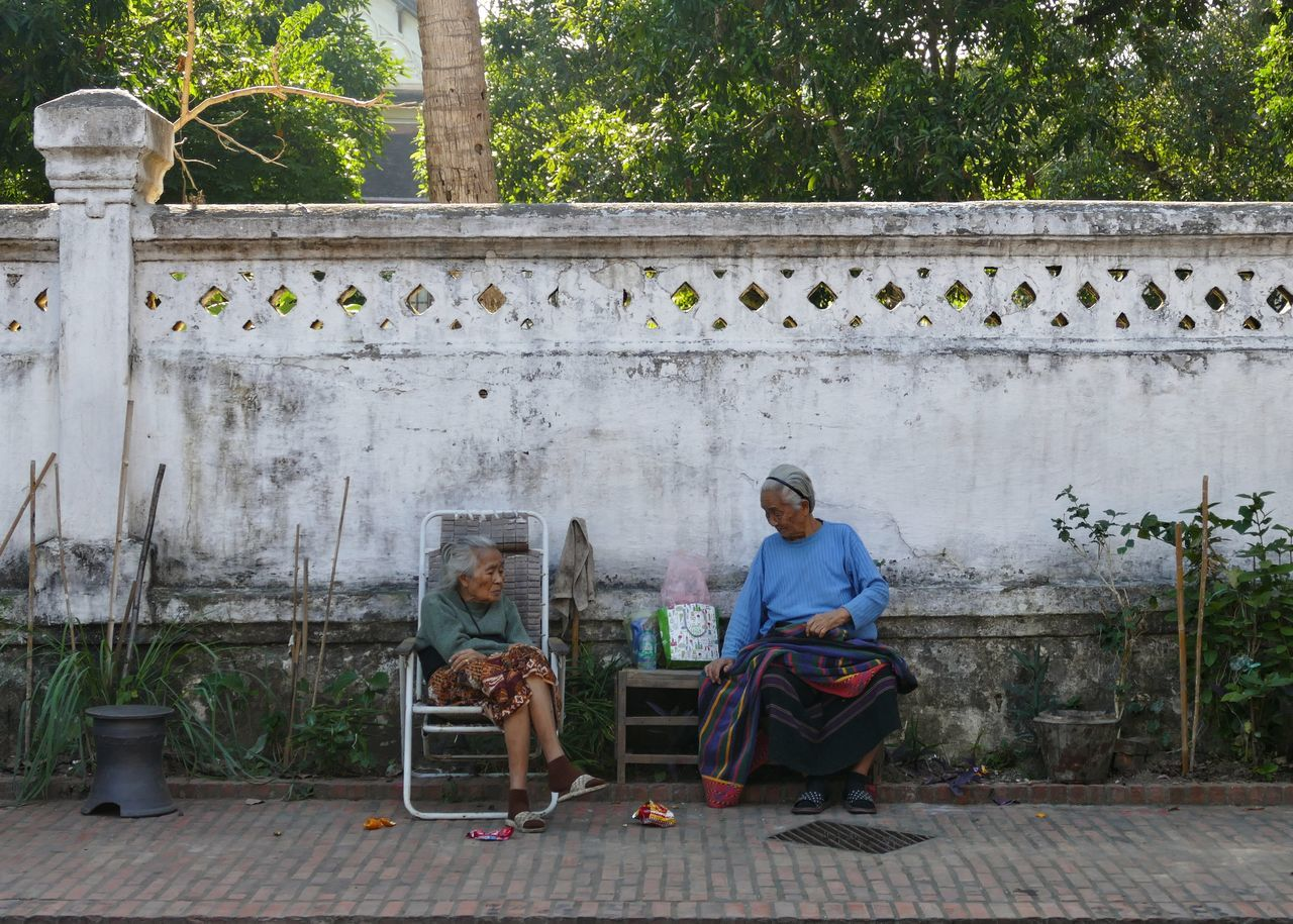 luang prabang laos ASIA women street photography Sitting Wall old woman The City Light Traveling People watching people outdoors Adult Travel Chair day women around the world