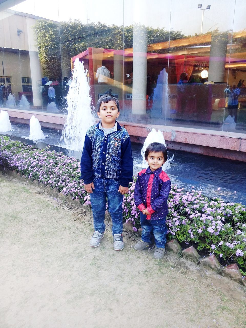 childhood, boys, looking at camera, outdoors, full length, real people, son, day, front view, happiness, warm clothing, smiling, togetherness, lifestyles, leisure activity, portrait, elementary age, family with one child, jacket, family, father, enjoyment, child, architecture, standing, building exterior, bonding, nature, young adult, people, adult