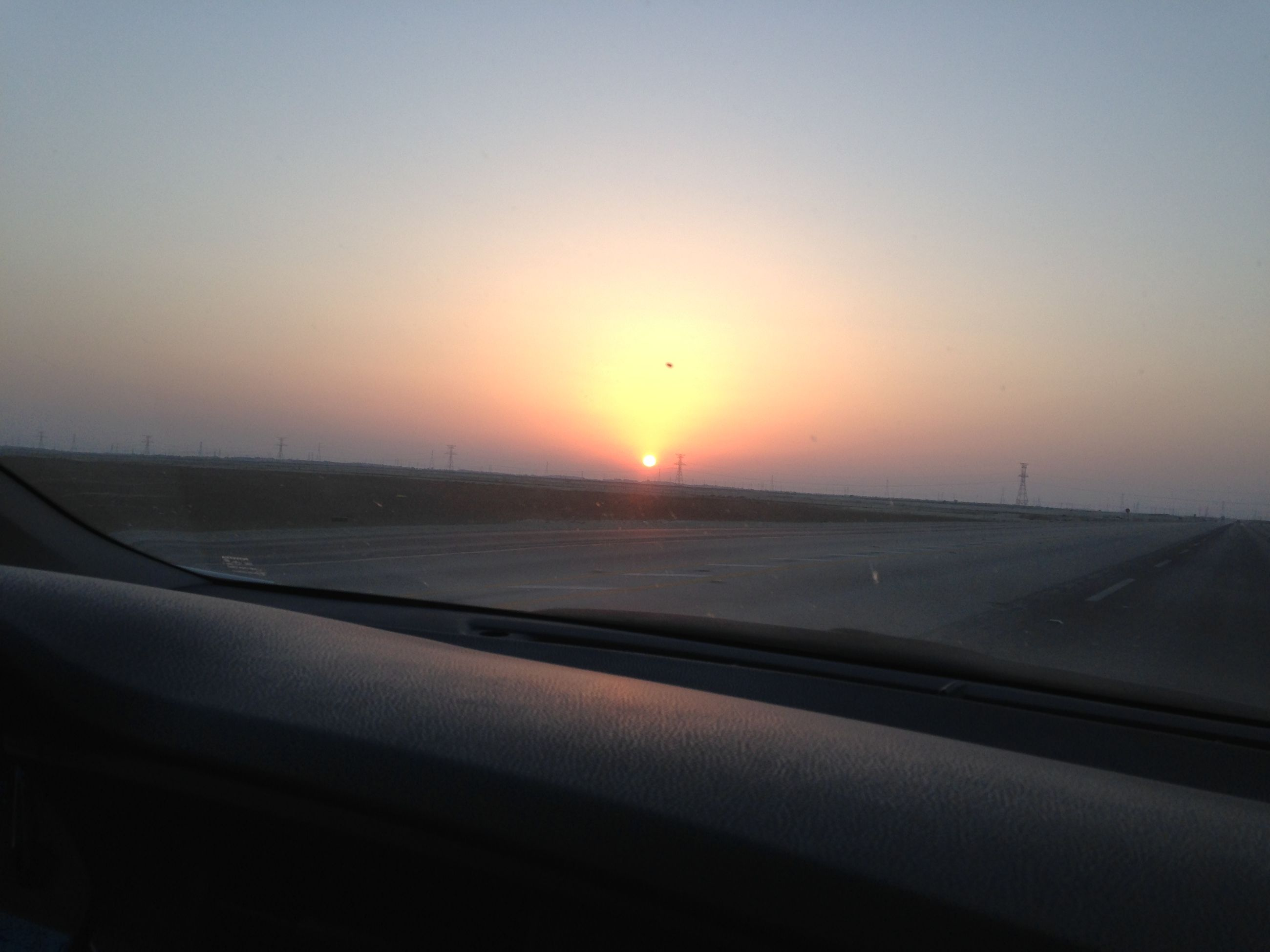sunset, transportation, mode of transport, sun, orange color, vehicle interior, airplane, scenics, beauty in nature, clear sky, glass - material, travel, sky, car, window, transparent, nature, copy space, part of, land vehicle