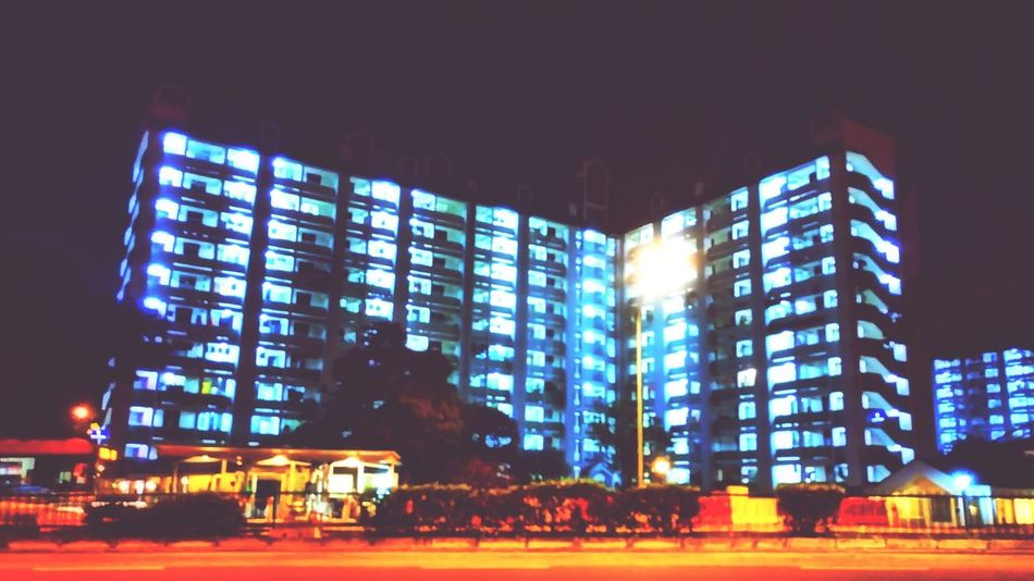Luminous dwellings Night City Architecture Building Exterior Illuminated Modern Skyscraper Built Structure Cityscape Travel Destinations Outdoors Urban Skyline Apartment Street City Urbanphotography Cityexplorer No People Urban Landscape Singapore