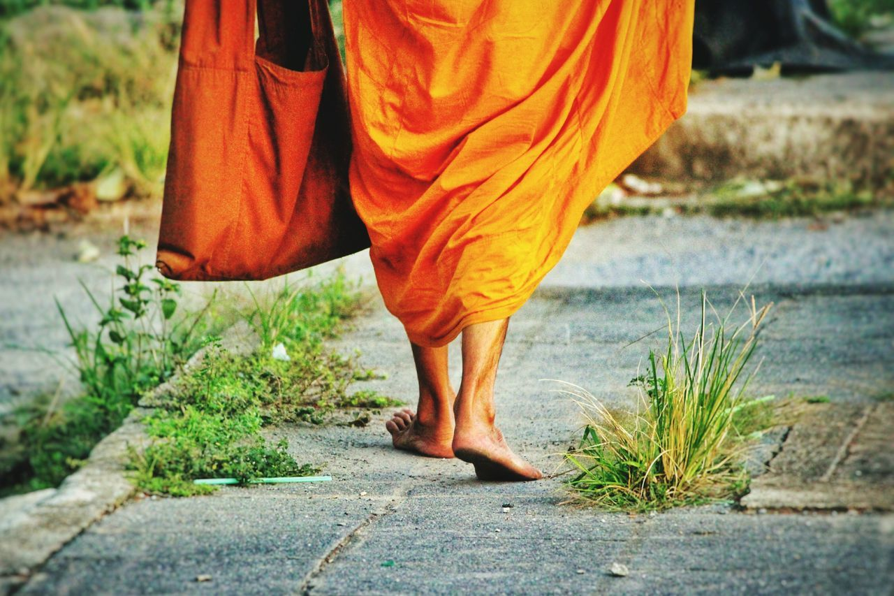 The road less travelled... Monk  Orange Road Bag Walk Walking Buddha Buddhism Buddhist Alone Spiritual Spirituality Feet Brown Path Life Simplicity Rich Colors Thailand Pastel Power Photography In Motion First Eyeem Photo Spotted In Thailand The KIOMI Collection Telling Stories Differently Long Goodbye Break The Mold TCPM BYOPaper! The Street Photographer - 2017 EyeEm Awards The Photojournalist - 2017 EyeEm Awards The Great Outdoors - 2017 EyeEm Awards
