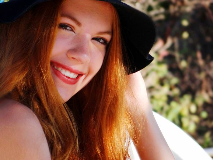 Redhead Long Hair Portrait Real People Looking At Camera Young Women Beautiful Woman Young Adult One Person Lifestyles Smiling Day Close-up Outdoors Happy Smile Happiness Hat