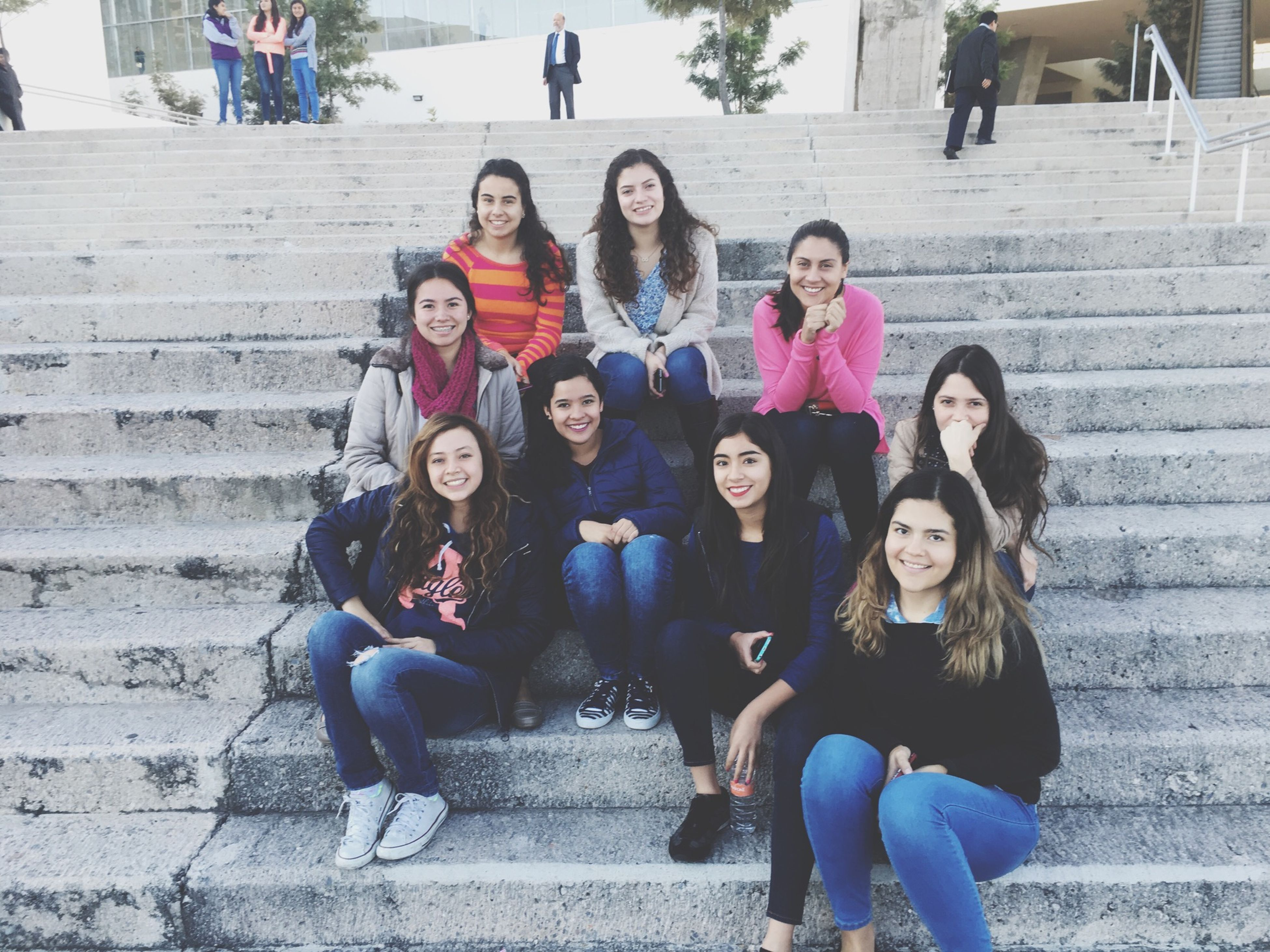 togetherness, lifestyles, leisure activity, steps, full length, young women, girls, friendship, casual clothing, person, medium group of people, teenage boys, teenage girls, young adult, front view, day, in a row, stairs, outdoors, looking at camera, looking