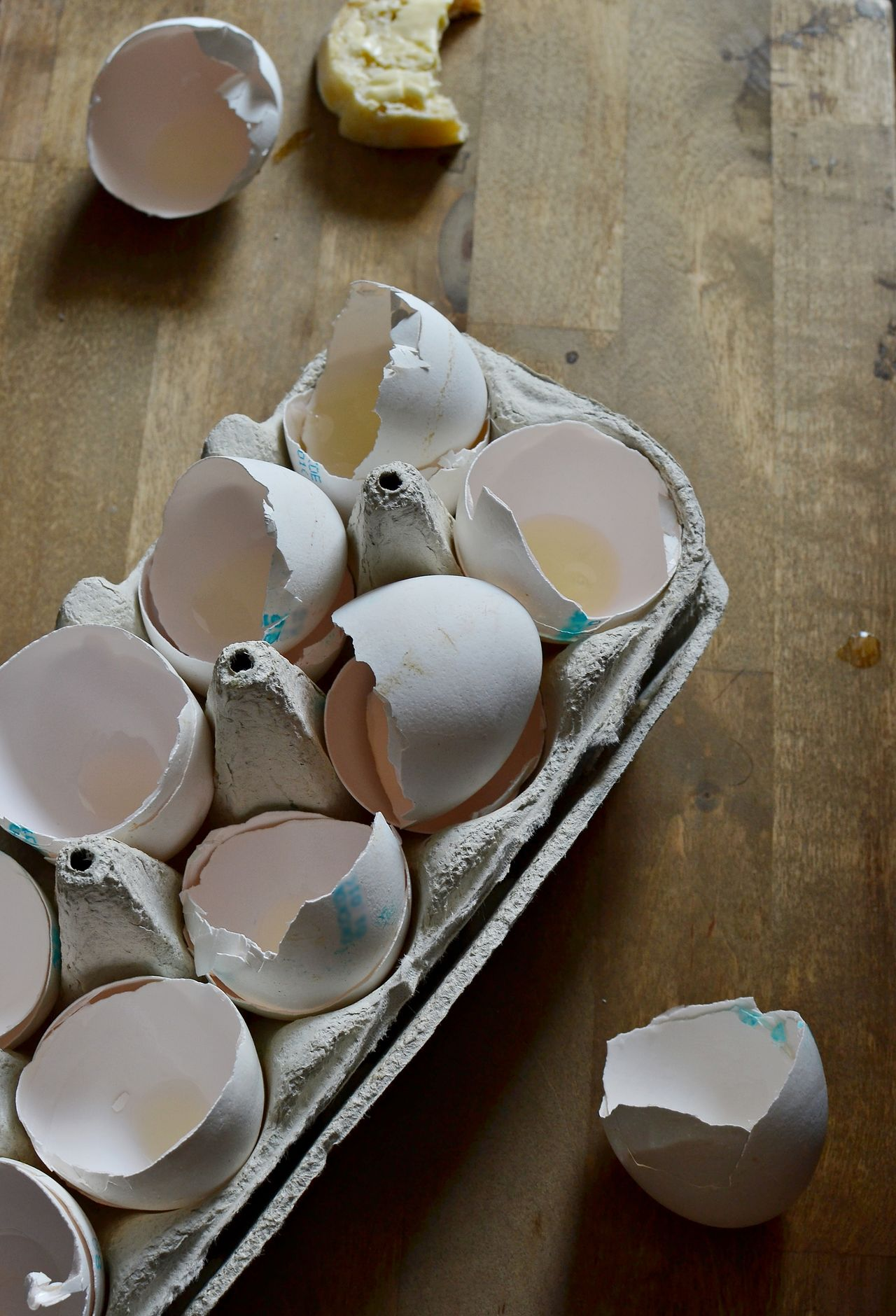 A carton box of empty egg shells Above Carton Box Close-up Cooking Egg Shells Eggs Empty Food And Drink Food Ingredients Freshness Full Of High Angle View In The Kitchen Indoors  No People Wooden Background