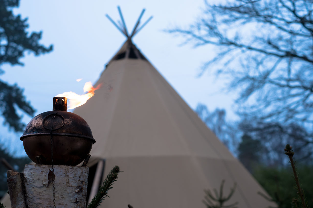 Close-up Copy Space Day Fire Focus On Foreground Hiking Indian Low Angle View Man Made Object No People Outdoors Sky Tent Tree