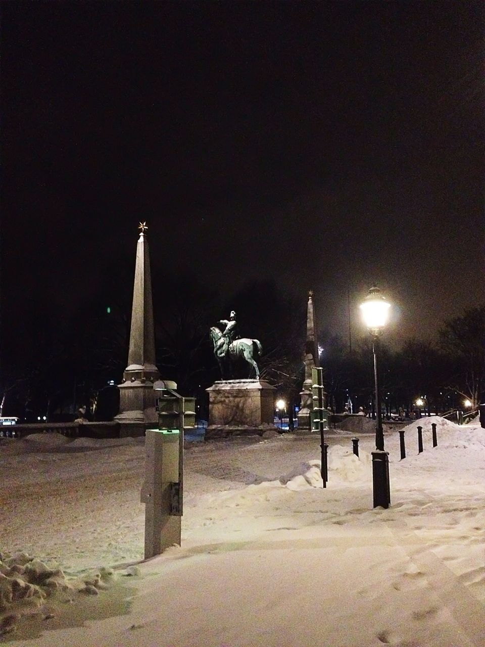 night, winter, illuminated, cold temperature, snow, street light, outdoors, sculpture, statue, travel destinations, no people, nature, architecture, sky