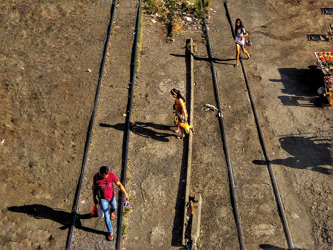 Mobile Photography Street Photography Eyeem Philippines Kulotitay Clicks High Angle View Railway Track Shadows & Lights Track Train Afternoon Walk Mobileglobalshooters Outdoors Walking Three People Diagonal From My Point Of View Flying High