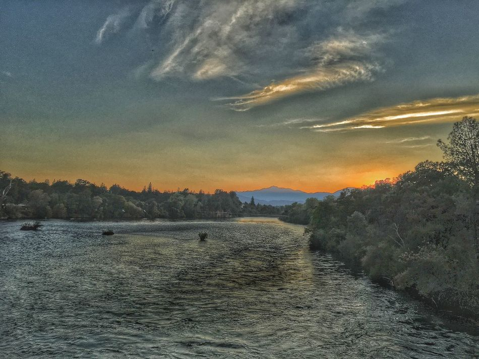 """""""Sacramemto River"""" Water Waterfront Tranquil Scene Scenics Tranquility Beauty In Nature River Nature Non-urban Scene Sky Mountain Outdoors Cloud - Sky Tourism Sea Majestic Vacations Dramatic Sky Wave No People Sacramento River Northern California Redding California"""