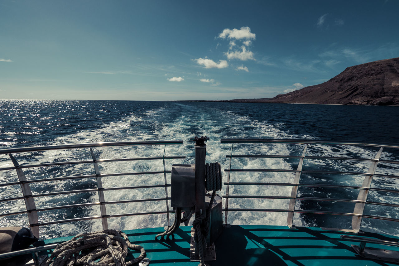 A ferry on its way to La Graciosa Beauty In Nature Blue Cloud - Sky Day Ferry Ferryboat Horizon Over Water Nature Nautical Vessel Outdoors Railing Scenics Sea Sky Water