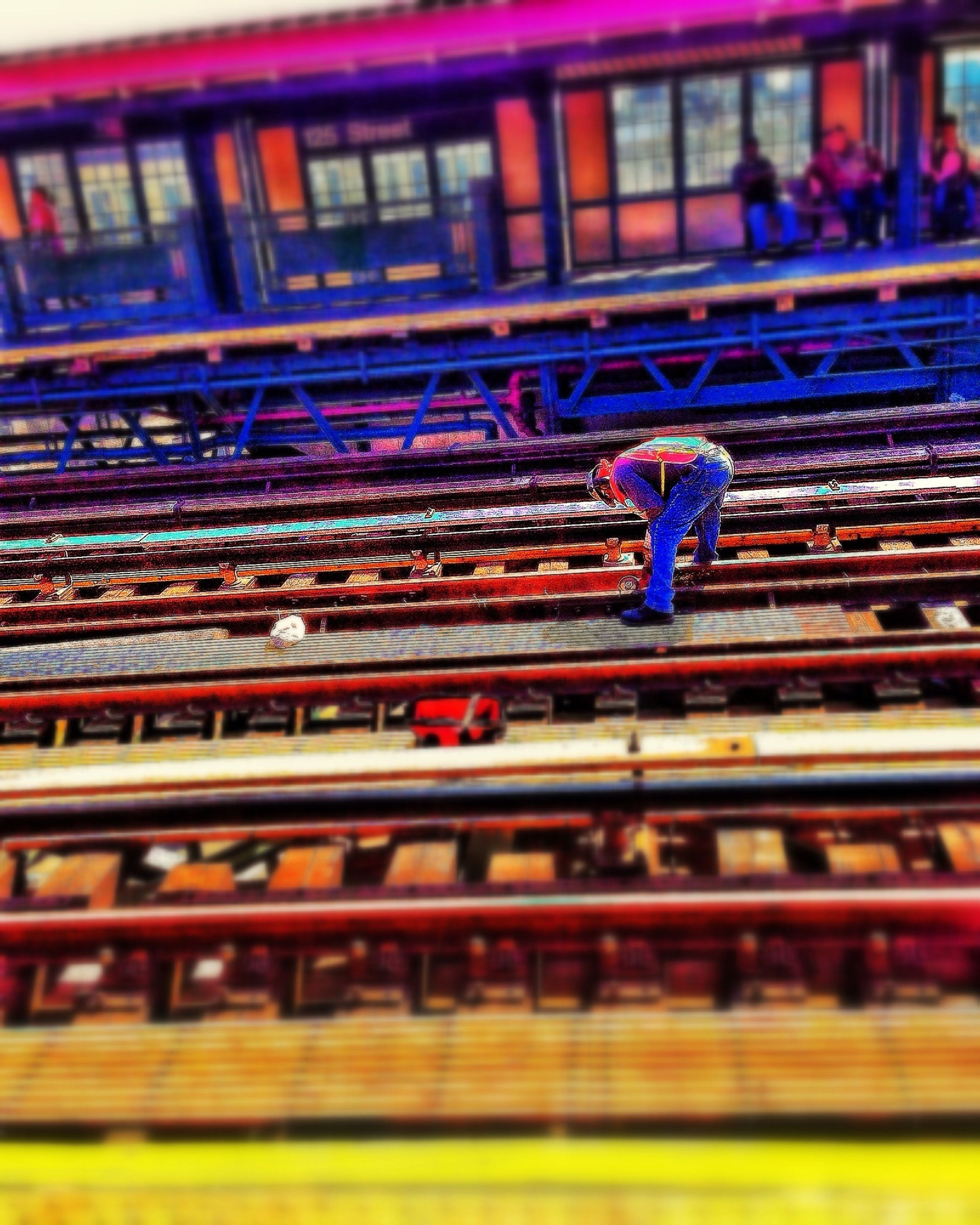 built structure, architecture, building exterior, motion, blurred motion, railing, selective focus, incidental people, long exposure, reflection, multi colored, outdoors, focus on foreground, steps, full length, side view, night, city