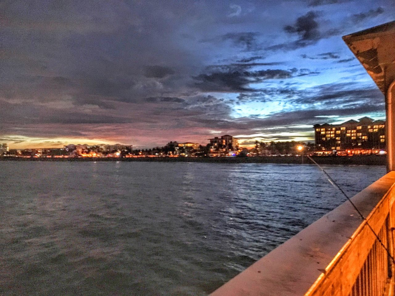 sky, cloud - sky, architecture, built structure, building exterior, water, sunset, no people, city, outdoors, river, nature, cityscape, scenics, beauty in nature, skyscraper, day, nautical vessel