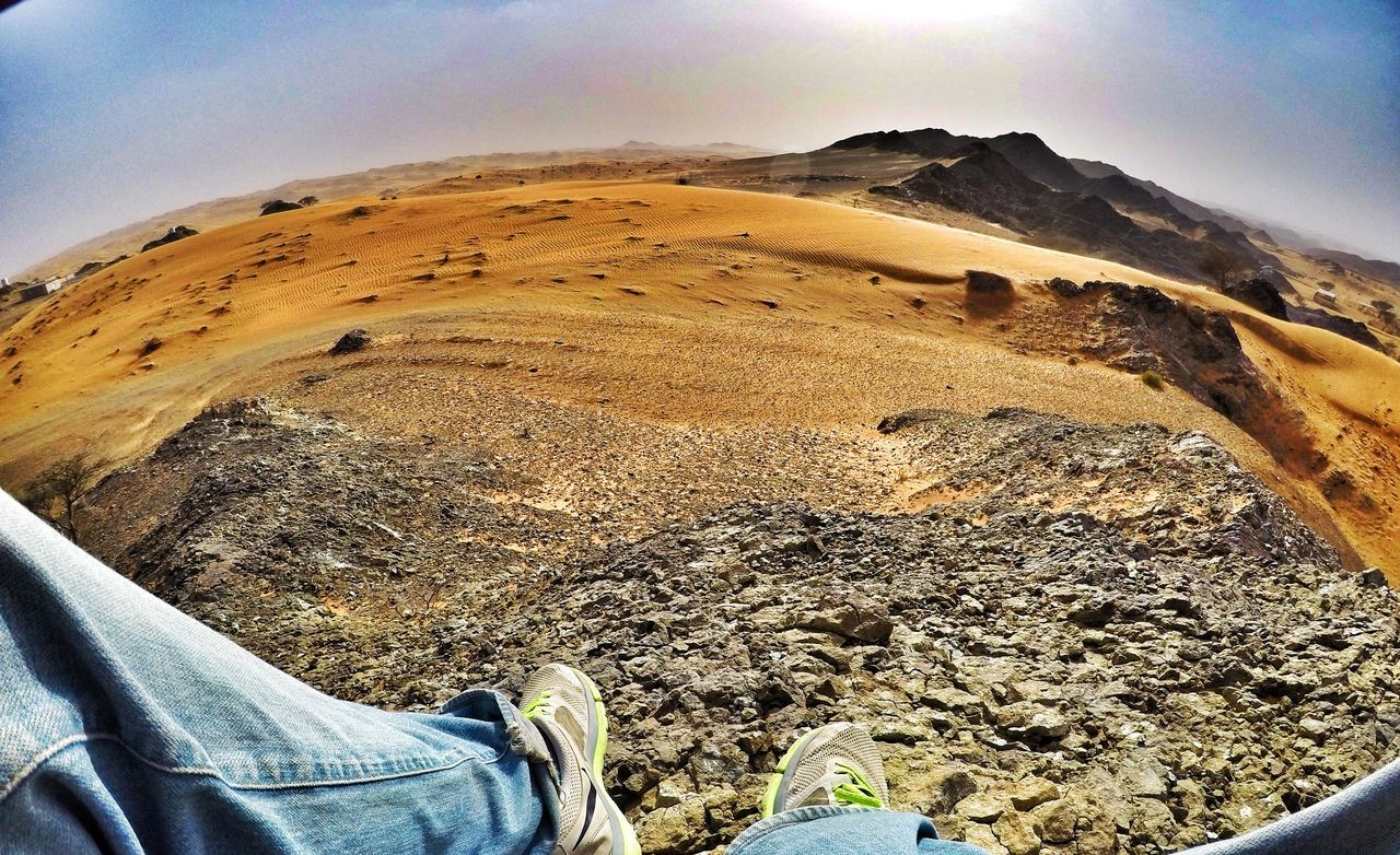 human leg, low section, mountain, landscape, one person, day, real people, shoe, nature, outdoors, sky, scenics, beauty in nature, human body part, men, close-up, people