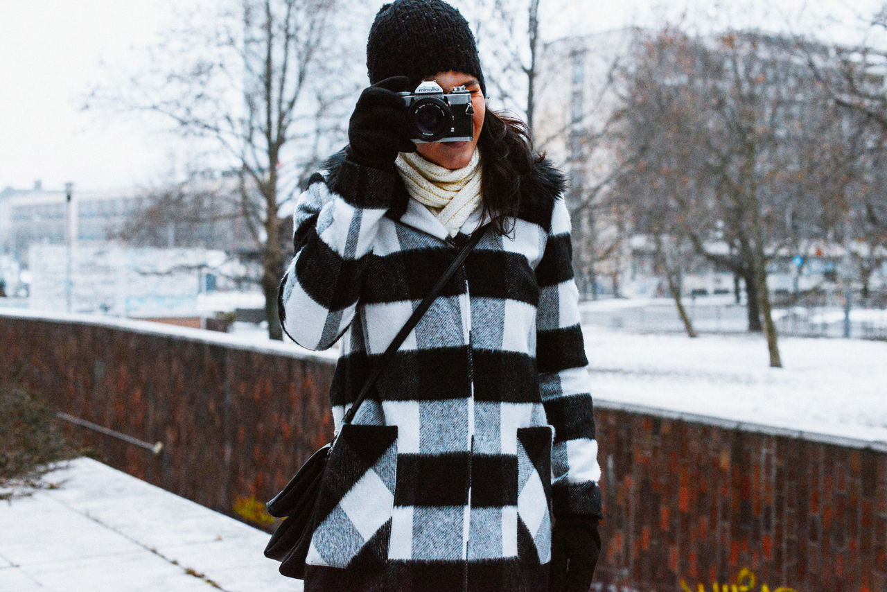 Analog Camera City Cold Cold Temperature Colors Day Fashion Frost One Person One Woman Only Outdoors Portrait Retro Snow Squares Taking Photos Tree Warm Clothing Winter Winter