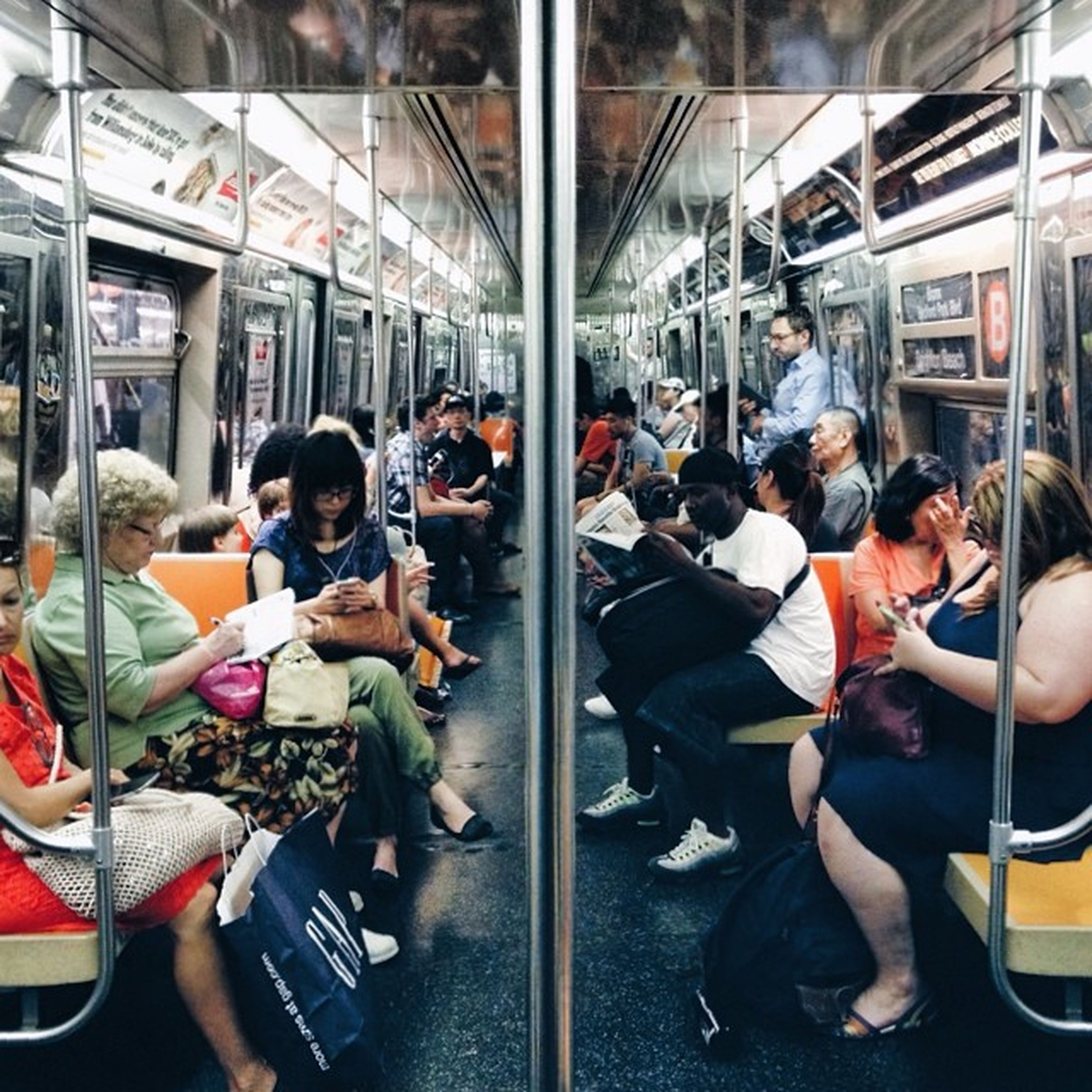 lifestyles, person, leisure activity, men, large group of people, transportation, sitting, mode of transport, indoors, casual clothing, travel, city life, medium group of people, vehicle interior, public transportation, passenger, togetherness, window, standing