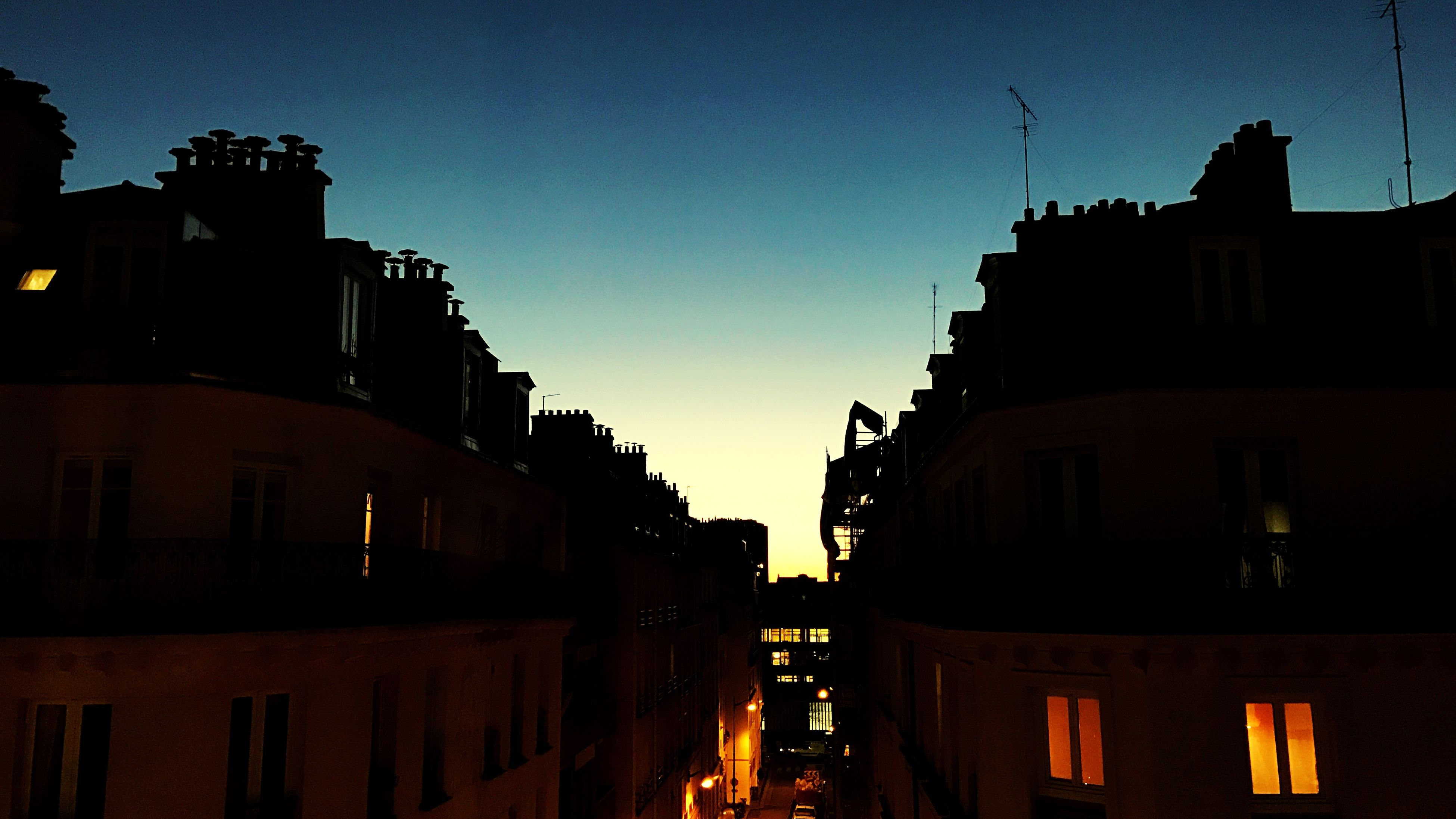 sunset, building exterior, architecture, dusk, built structure, silhouette, illuminated, city, sky, outdoors, night, no people, nature, cityscape