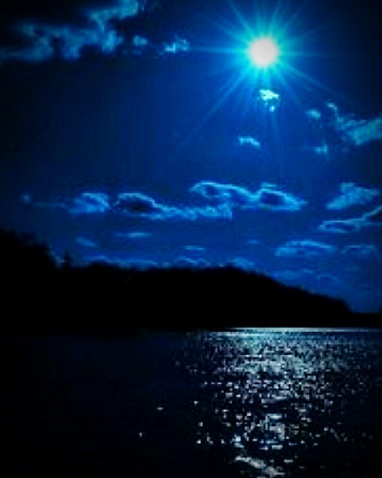 Blue Outdoors Dark Sky Scenics Tranquil Scene Horizon Over Water Water Lightning No People EyeEmNewHere Black Scratch Artwork Check This Out Arts Culture And Entertainment Photography Illuminated Dark Art Tranquility Glowing Moonlight Moon Reflection Water Reflections, Glowing Moon