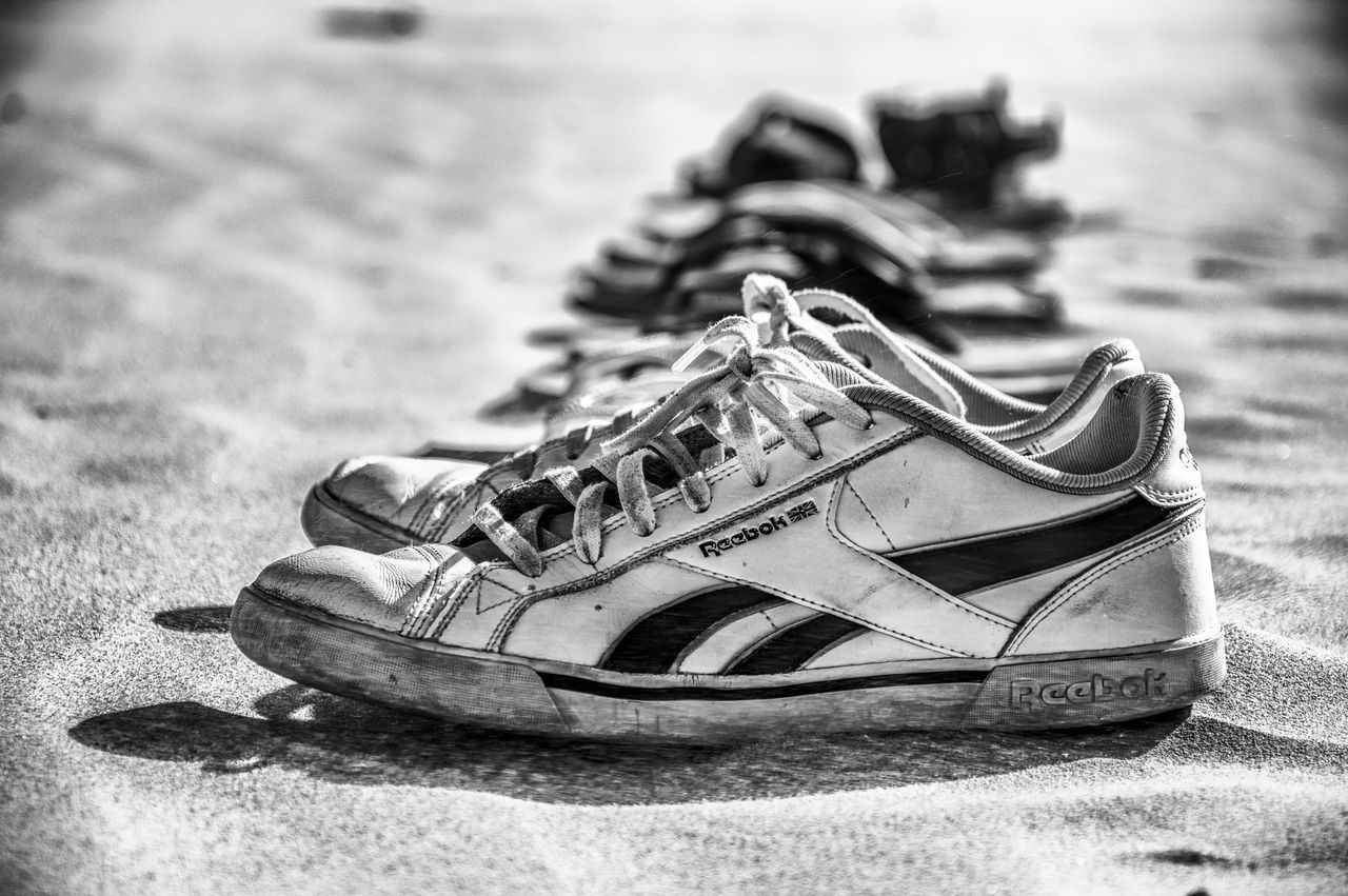 Sneakers on the beach Array Beach Beach Life Casual Close-up Day Focus On Foreground Holidays No People Outdoors Row Sand Sea Shopping Shore Sneakers Sportive Vacation Vacation Time