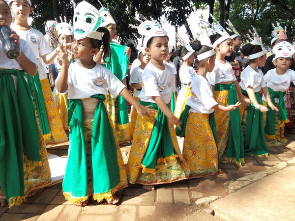 8). Colosal Kids Dance On Street Sunday Mass Traditional Costume Traditional Culture Gathering. Facial ExpressionsObserving People in Jakarta, Indonesia