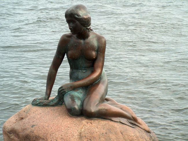 The Little Mermaid at Langelinie on Copenhagen's Waterfront in Denmark - Water Vacations Relaxation Shirtless Sea Sitting Leisure Activity Lifestyles Tourism Weekend Activities Tourist Rippled Full Length Solitude Tranquil Scene Travel Destinations Summer Day Non-urban Scene Resting The Little Mermaid Copenhagen Langelinie Denmark