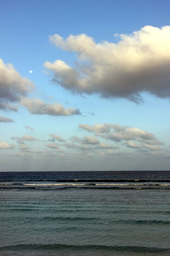 Clouds And Sky Distant Edge Of The World Green Blue Water Moody Sky Moon Scenics Small Tides Tranquility Vacations
