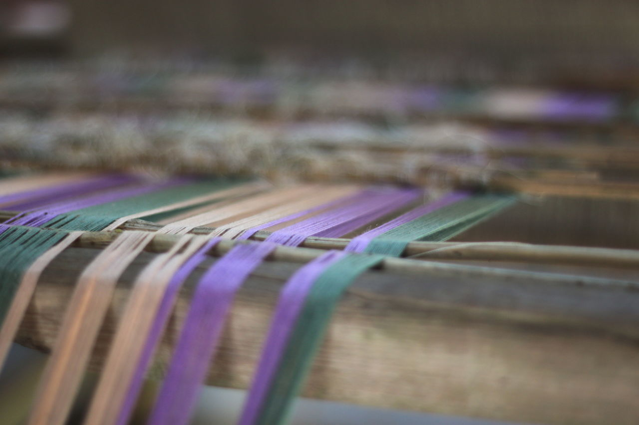 close-up, no people, selective focus, indoors, multi colored, choice, loom, day