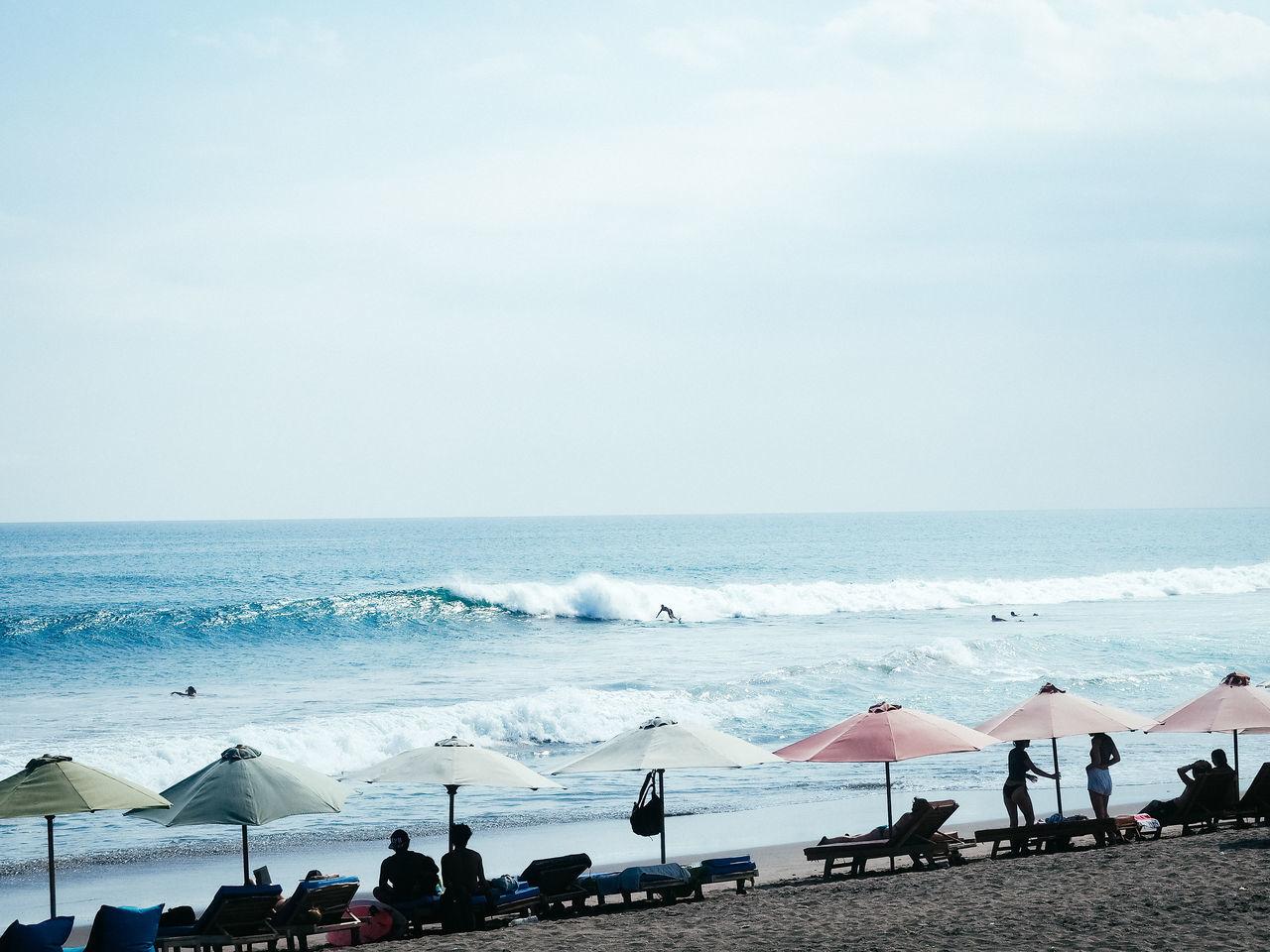 Vacation Feels Bali Bali Beach Beach Beach Umbrella Beachphotography Canggu Coastline Colourful Umberella Horizon Over Water Sea Surfer Surfing Tourist Traveling Umbrealls Vacation Waves