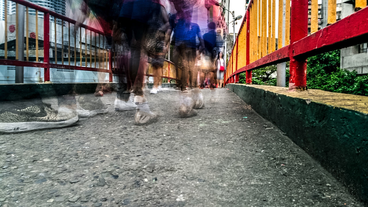 architecture, built structure, motion, real people, building exterior, city, blurred motion, outdoors, day, transportation, water, men, low section, one person, people