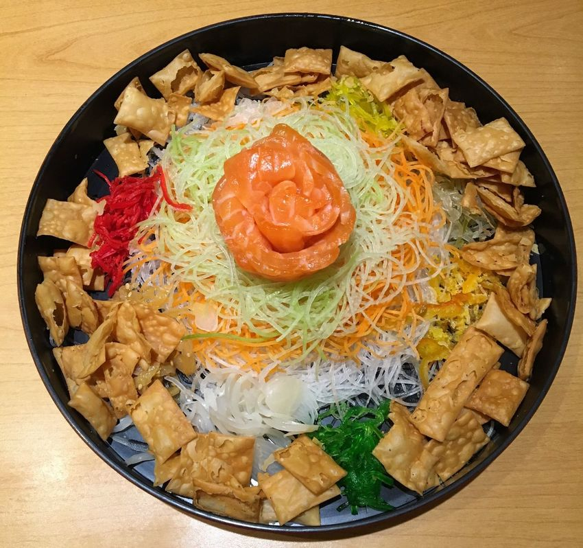 Yu Sheng or Lo Hei or Prosperity Toss - raw fish salad dish with various sauces and condiments. A Chinese New Year dish traditionally served on the seventh day of the Lunar New Year for prosperity and longevity. Yu Sheng Lo Hei Prosperity Toss Prosperity & Luck Longevity Lunar New Year Chinese New Year Traditional Food Gastronomy Food Food For Goodluck Salmon Sashimi Sliced Salmon Salmon Salad Raw Salmon
