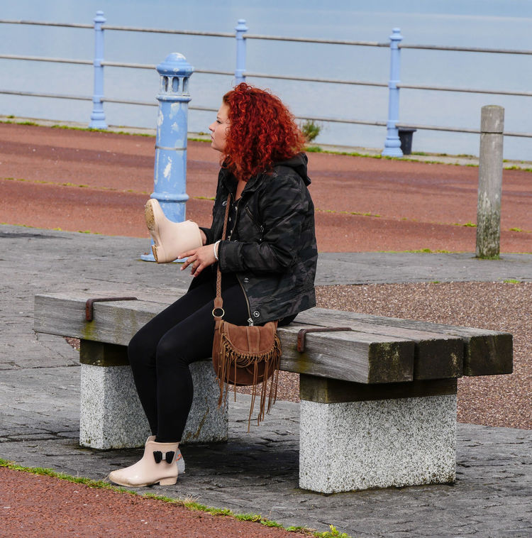 Street Photography Streetlife Young Woman Red Hair Sitting Bench Boots Seaside Promenade Sea Railings Watching Picsartrefugees