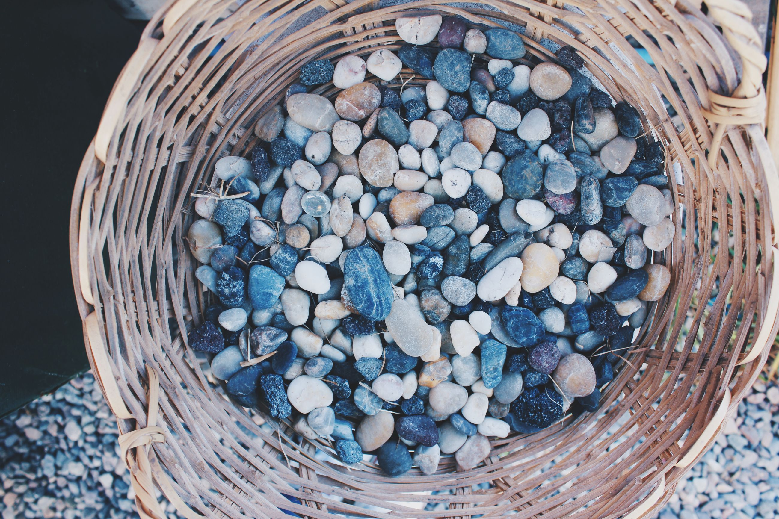 Close-Up High Angle View Of Pebbles In Baskets
